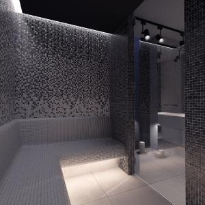 Sauna parowa to miejsce na domowy relaks. Ciemna mozaika złożona z drobnych elementów ciekawie odbija tu refleksy świetlne.