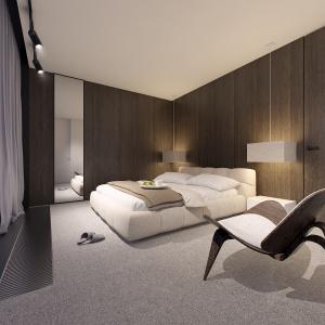 Sypialnia jest urządzona w bieli brązach. Główne skrzypce odgrywa tu drewno.
