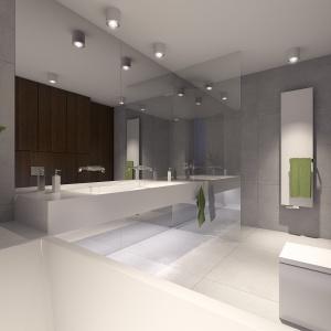 W tej łazience również dominuje biel i szarość.