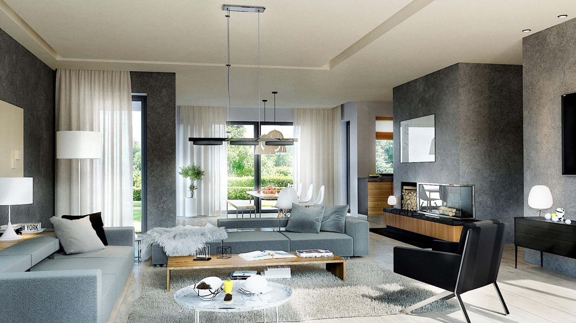 Pokój dzienny zaprojektowano w jasnych barwach. Biel, szarość i kolor morza to kolory dominujące w salonie. Fot. Pracownia Projektowa Archipelag