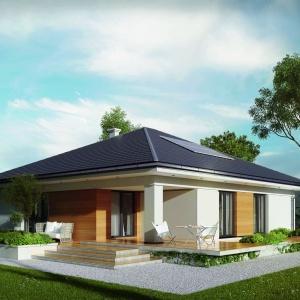 Duże przeszklenia i częściowo zadaszony taras w naturalny sposób łącza dom i ogród. Fot. MTM Styl
