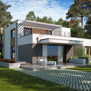 Od strony ogrody zaprojektowano piękne tarasy: jeden nad garażem, drugi nażniemy. Zapewnią one komfortowy wypoczynek w letnie dni. Fot. Archetyp