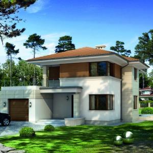 Jasne wnętrze domu z interesującymi drewnianymi akcentami jest kontynuacją charakteru elewacji – białego tynku uzupełnionego drewnem. Fot. Biuro Projektów MTM