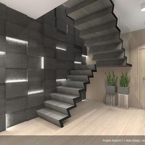 """Dywanowe schody """"lekko"""" unoszą się w przestrzeni i stanowią centralny punkt holu. Projekt:  Aksamit 2, arch. Tomasz Sobieszuk, Biuro Projektów MTM Styl"""