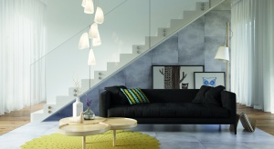 Szukacie pomysłów na wnętrze w loftowej stylistyce? Sięgnijcie po niezawodne szarości, którym domowego ciepła dodadzą dekoracje z naturalnego drewna.