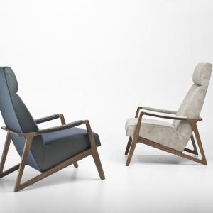 BARLEY z wysokim oparciem oraz drewnianą ramą oddaje urok klasycznych foteli wypoczynkowych z lat 60. ub. w. Rama z masywnego drewna orzechowego, pokryty tkaniną lub skórą. Fot. 4 Mariani