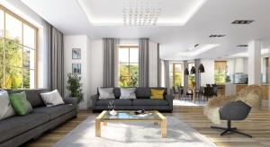 Otwarta przestrzeń dzienna wypełniona światłem. Do tego biel i szarość ożywione barwnymi dodatkami. Nowoczesną willę zaprojektowano niezwykle modnie i funkcjonalnie.