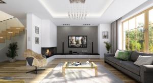 W nowoczesnym wnętrzu zaprojektowano na parterze dużą otwartą przestrzeń dzienną, z salonem, jadalnią, holem z wyeksponowanymi schodami, oraz kuchnią.