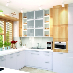 Kuchnia to wyjątkowo praktyczne i zarazem subtelne połączenie bieli i drewna. Kuchnię zaprojektowano jako zamkniętą, tuż obok jadalni.  Fot. Pracownia Projektowa Archipelag