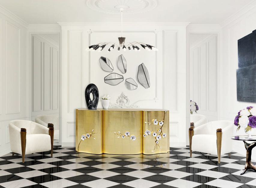Trendy 2017 - biel, złota i szlachetna elegancja. Na zdjęciu komoda Honor, ręcznie wykonana, dekorowana płatkami złota. Fot. Memoir