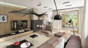 Aria to dom jednorodzinny, z poddaszem użytkowym i dachem wielospadowym.Elegancka bryła budynku, zaprojektowana w klasycznym stylu, podkreślona została nowoczesnymi wykończeniami. Wnętrze zaprojektowano nowocześnie: dominuje w nim drewno i świat