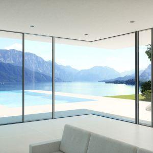 Duże przeszklenia: fasadowe okna i duże drzwi podnoszono-przesuwne. Fot. Schüco