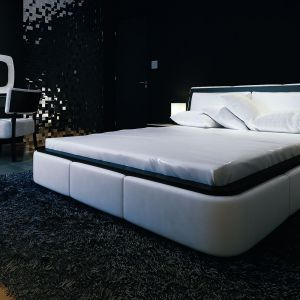 Sypialnia gospodarzy jest urządzona niezwykle nowocześnie. Tu tło dla białego łóżka stanowią czarne ściany. Dom Ambrozja. Projekt: arch. Tomasz Sobieszuk. Fot. MTM Styl