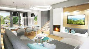 Współcześni Inwestorzy najczęściej wybierają projekty domów, w których strefa dzienna stanowi otwartą przestrzeń.Taki układ daje możliwość bardziej efektywnego zagospodarowania powierzchni i doskonale sprawdza się zwłaszcza w małych dom