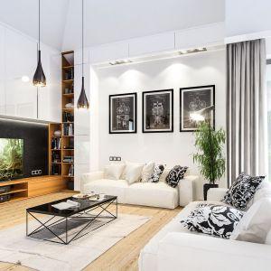 Podobnie jak bryła domu, wnętrze urządzone jest nowocześnie, ale w bardzo stonowanej i eleganckiej kolorystyce. Projekt: arch. Michał Gąsiorowski. Fot. MG Projekt