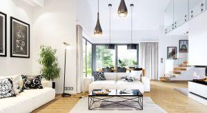 """Piękny, niespełna 120- metrowy dom jednorodzinny dla 4-osobowej rodziny, zbudowany na planie litery """"T"""". Dom jest nowoczesny, ale też stonowany, bez awangardowej przesady."""