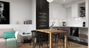 """Wystrój mieszkania inspirowany stylem skandynawskim.Aranżacjapełnapomysłowych i intrygujących dodatków - łazienka czaruje piękną mozaiką, w sypialni przysłowiową """"wisienkę na torcie"""" stanowią grafiki, a w kuchni wszystkie wa�"""
