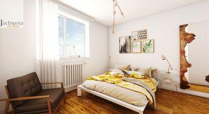 Prosta minimalistyczna sypialnia z dużą zabudową na przechowywanie z akcentami miedzi.