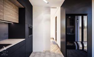 Projekt zabudowy kuchni, która została ukryta za przesuwnymi drzwiami.