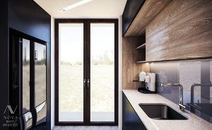 Projekt zabudowy kuchni, gdzie całe wnętrze doświetla wysokie okno.