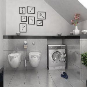 Szara łazienka zaprojektowana jest minimalistycznie. Połysk metalu i szarość betonu uzupełniają tu drobne czarne akcenty. Fot. Dom dla Ciebie Pracownia  Projektowa Archeco