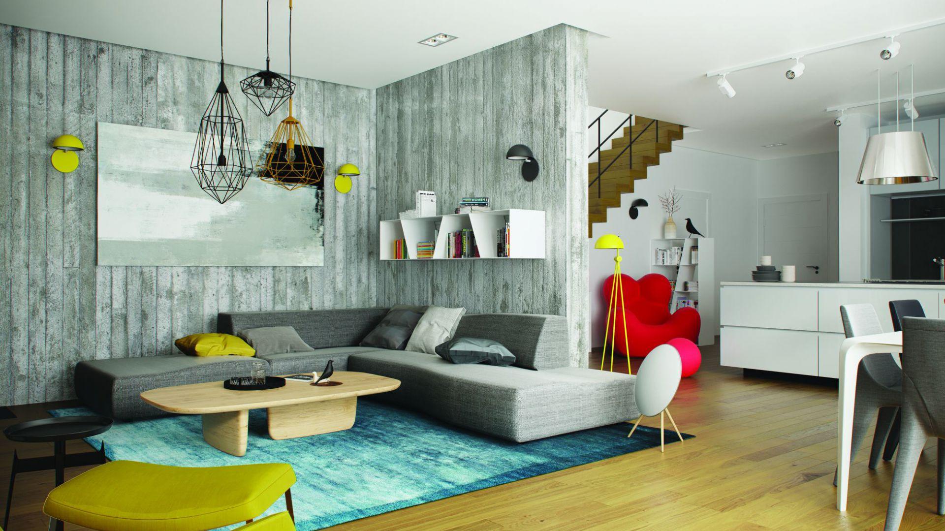 W strefie dziennej rządzą pogodne, energetyczne kolory, dzięki którym całość emanuje świeżością i pozytywną energią. Uwagę zwracają dekoracyjne lampy, a także stylowe dodatki, subtelnie akcentujące elegancki charakter wnętrza. Dom EX 17 W2 Energo Plus. Projekt: Artur Wójciak. Fot. Pracownia Projektowa Archipelag