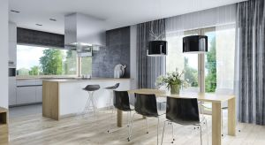 Piękny, parterowy dom o powierzchni 158 metrów kwadratowych kryje w sobie minimalistyczne wnętrze urządzone w bieli i szarościach.