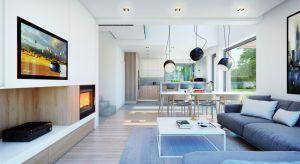 Funkcjonalny i nowoczesny dom z poddaszem, o powierzchni użytkowej ponad 140 mkw, kryje w sobie niezwykle praktycznie urządzone wnętrze. Ciekawa bryła, w połączeniu z jasnym wystrojem, będzie receptą na wymarzony dom.