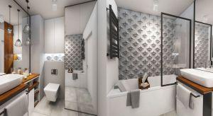 Łazienka o powierzchni4,5 m2 to projekt na warszawskiej Pradze. Wnętrze charakteryzuje sięmocnymi kontrastami kolorystycznymi oraz różnorodnościąmateriałów i faktur.