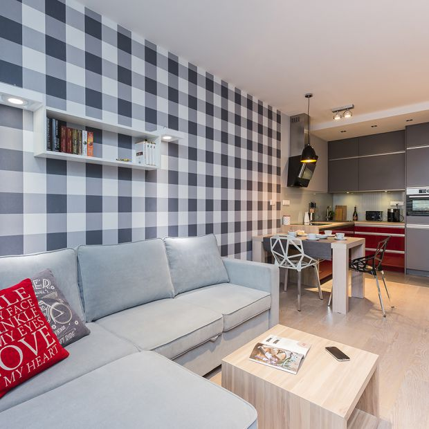 Mieszkanie z czerwienią w roli głównej - gotowy projekt wnętrza