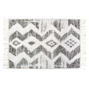 Bawełniany dywan Boucherouite z geometrycznym nadrukie nadaje artystyczny wygląd. Fot. HK Living