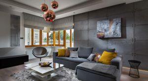 Surowy, oszczędny w formie, minimalistyczny. Ocieplony jednak dawką słonecznej miedzi. Taki jest luksusowy apartament położony na gdyńskim wybrzeżu.