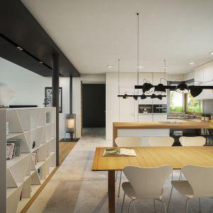 Jadalnia została urządzona nowocześnie i ze smakiem - w jej centrum mamy piękny drewniany stół. Dom EX 18 G2 Energo Plus. Projekt: arch. Artur Wójciak. Fot. Pracownia Projektowa Archipelag