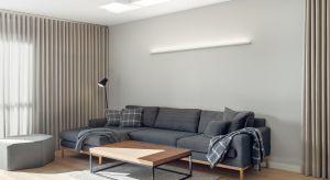 Dwupoziomowa przestrzeń powstała w wyniku połączenia ze sobą dwóch mieszkań. Styl wnętrza jest współczesny, dominują barwy szarości i bieli z powtarzającym się motywem graficznym kratek i pasków. W strefie komunikacji znalazły się szklane