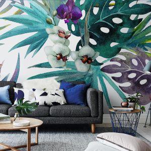 Fototapeta Orchidea na podkładzie winylowym. Jej wzór tworzą liście hibiskusa i kwiaty orchidei. Cena: 99 zł/m2, Pixers. Fot. Pixers