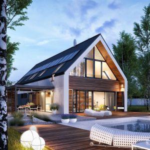 Elewacje ogrodowa urokliwie prezentuje się w scenerii nocnej. Dom EX 19 G2 Energo Plus. Projekt: Artur Wójciak. Fot. Pracownia Projektowa Archipelag