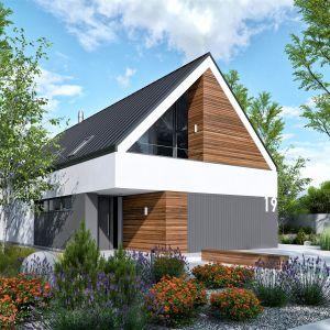 Elewacja domu to najmodniejsze połączenie drewna, szarości i ponadczasowej bieli, które zachwyca swoją elegancją i szlachetnością. Dom EX 19 G2 Energo Plus. Projekt: Artur Wójciak. Fot. Pracownia Projektowa Archipelag