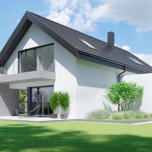 Elewacja domu została skomponowana z płyt betonowych i białego tynku oraz połączona z antracytową, płaską dachówką. Dom HomeKONCEPT 51. Projekt i zdjęcia: Zespół Projektowy HomeKONCEPT
