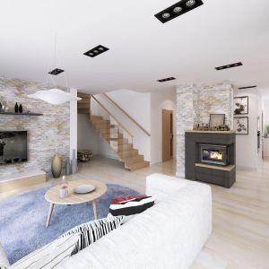 Piętrowy dom wykończono bardzo praktycznie i zarazem z dużą dozą elegancji. Dominuje tu biel, kamień i jasne drewno. Parter i piętro pozwalają na praktyczny podział stref w domu. Fot. Dobre Domy