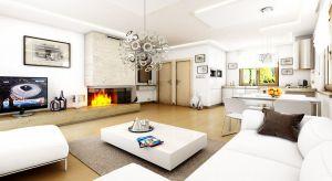 Salon otwarty na kuchnię i jadalnię to coraz częściej stosowane rozwiązanie, zwłaszcza w małych domach. Tego typu zaprojektowanie open space'u jest bardzo częstym zabiegiem architektonicznym powiększającym optycznie niewielkie wnętrze.