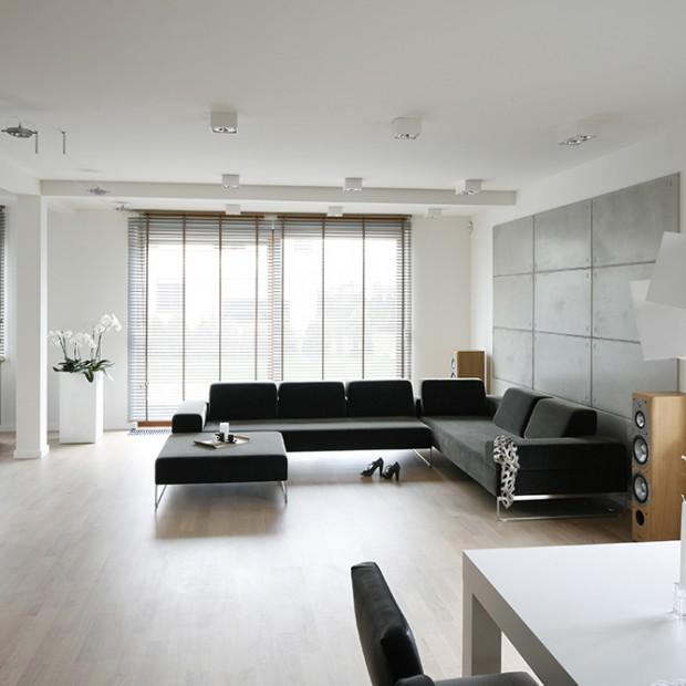 Betonowa ściana. Pomysł na minimalistyczne mieszkanie