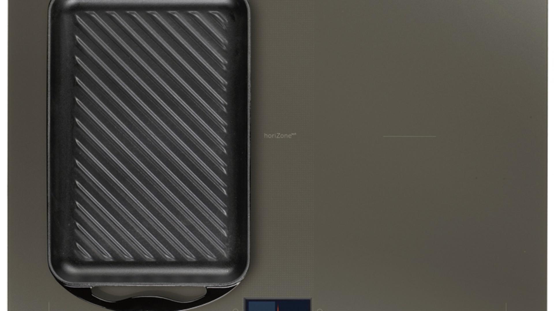 Płyta indukcyjna Horizone Tech I5DE-6000V, dzięki dołączonemu wysokiej jakości grillowi żeliwnemu pozwala przygotować grillowane dania, kiedy tylko najdzie nas ochota. Cena: ok. 3.100 zł, Mastercook.
