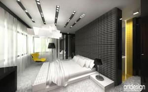 Sypialnia w kolorystyce biało - szarej z charakterystycznym żółtym fotelem