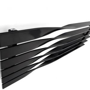 Grzejnik Cyklon zaprojektowany przez M4M studio, występuje w wersji pionowej i poziomej. Wygięte profile tworzą minimalistyczną formę. Fot. Terma.