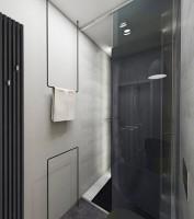 Dom w Baszkówce - łazienka w czerni i szarości.