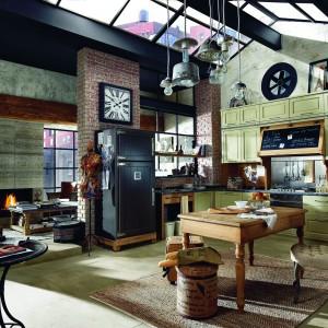 Kuchnia Nolita w ciepłym, domowym stylu vintage. Ciekawie prezentuje się szczególnie obudowa okapu, jak również lodówki. Drewniana, dostępna w różnych wykończeniach. Wycena indywidualna, Marchi Cucine/Art de Vivre.