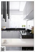 Czarno-biała kuchnia przełamana ciepłym drewnem.