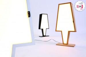 """Symbol swoim kształtem nawiązuje do archetypu lampy z abażurem. Największym atutem użytkowym jest wykorzystanie energooszczędnego źródła światła LED. Lampy SYMBOL mają moc zaledwie 4,6W. Prezentowana na wielu wystawach i targach. Została rekomendowana do konkursu """"Dobry Wzór 2011″ organizowanego przez Instytut Wzornictwa Przemysłowego."""