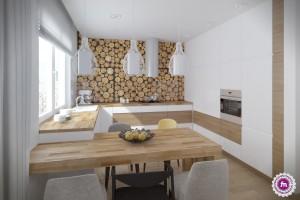 Kuchnia z pieńkami na ścianie.