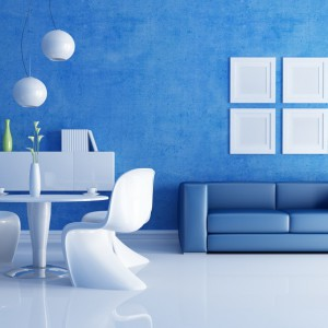 Nowoczesny pomysł na biało-niebieski salon. Fot. JK Interior.